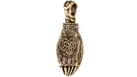 Фотография бронзовой лапы Велеса, вид в профиль.